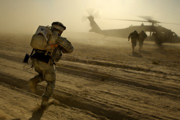 U.S. Army soldiers run towards a UH-60 Black Hawk helicopter as they are extracted after completing an aerial traffic control point mission near Tall Afar, Iraq, on June 5, 2006.  The soldiers are from Bravo Company, 4th Battalion, 23rd Infantry Regiment, 172nd Stryker Brigade Combat Team and the Black Hawk aircrew is from Bravo Company, 1st Battalion, 207th Aviation, Alaska National Guard.  DoD photo by Staff Sgt. Jacob N. Bailey, U.S. Air Force.  (Released)